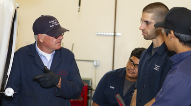 Faculty talking to automotive students. photo © Robin Spurs