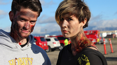 Two COC EMT students with moulage at drill.
