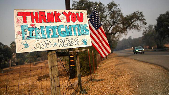 A handmade sign thanking the FireFighters.