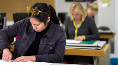 Inerior Design students working at drafting tables. photo © Robin Spurs