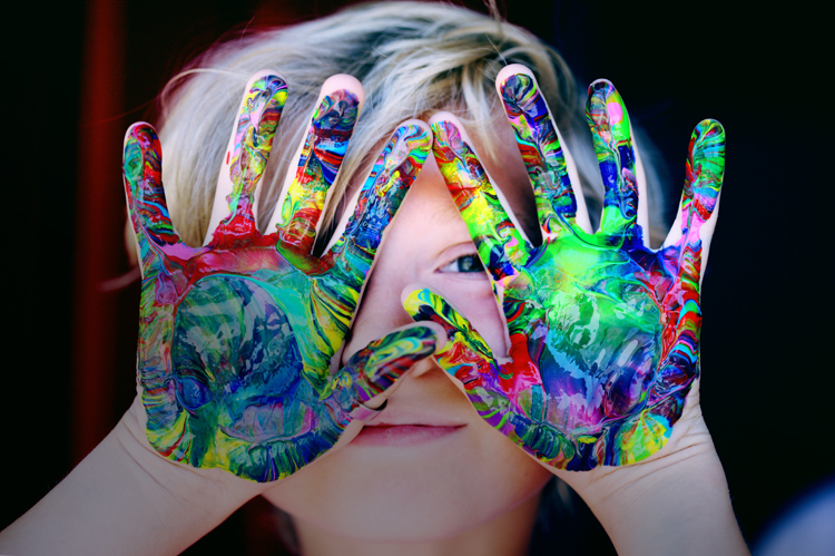 Child with beautiful painted hands.