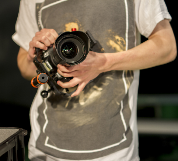 Media Entertainment Arts student holding camera.