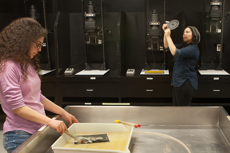 COC Photography students in darkroom.