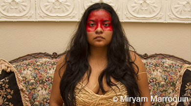 Young woman painted with red stripe across face