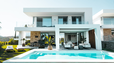 Beautiful home at evening wtih lights and pool.