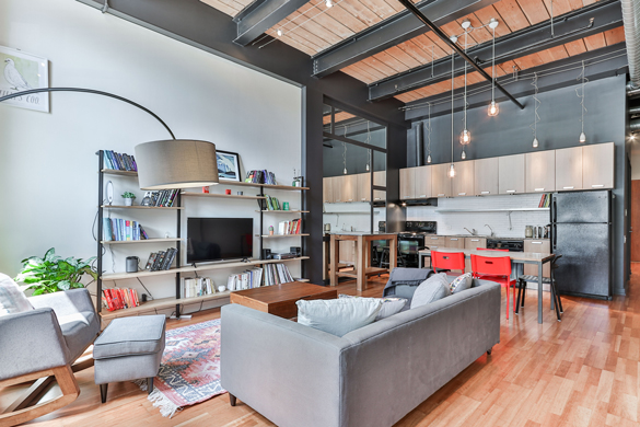 Exterior of classic home at evening, with pool.