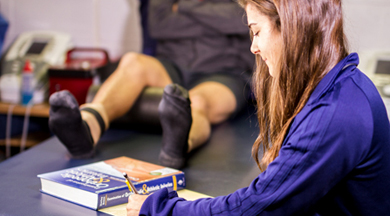 Sports Medicine student writing a report.  photo © Robin Spurs