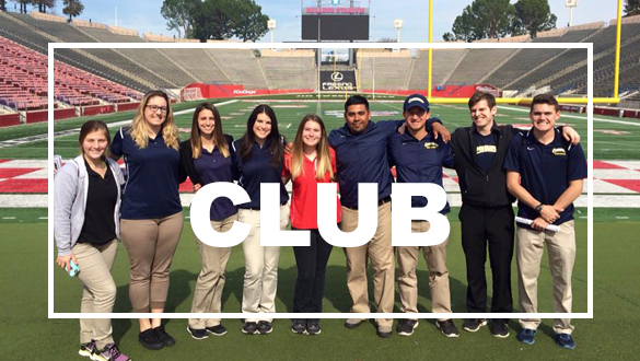 Sports Medicine students posing on football field.