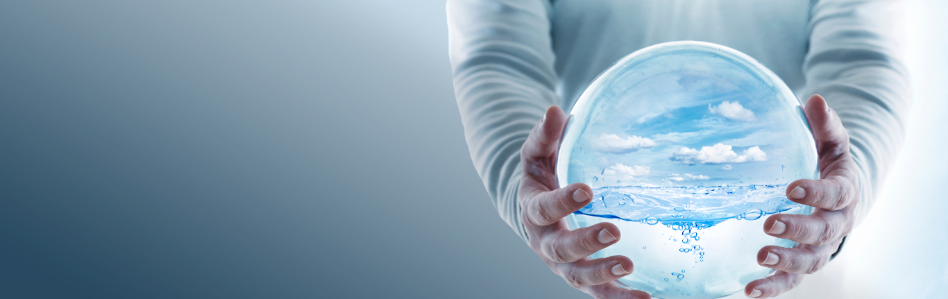 Water Systems Technolgy - Man holding water globe.