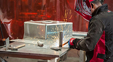 Welder in workshop.
